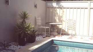 Stone table and chairs poolside