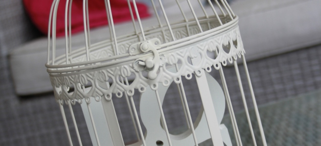 toy bird cage with the word LOVE inside